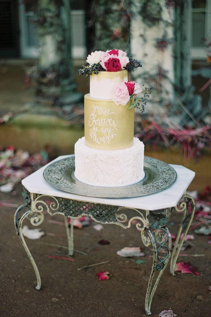 Amazing-Wedding-Cakes-Gold-Fondant-White-Ruffles-Quote