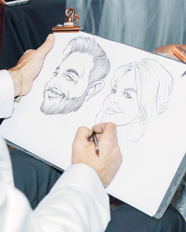 Caricatures are a fun and interactive wedding favour for your guests | Sandra Åberg Photography via Martha Stewart Weddings