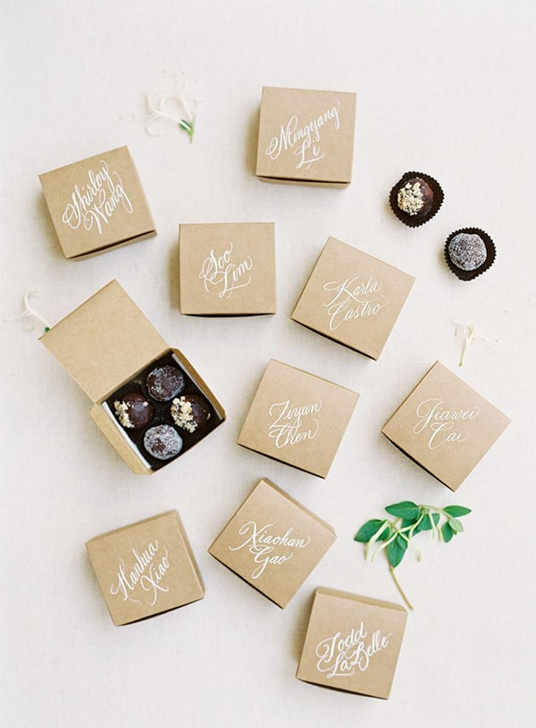 Individually boxed chocolate truffle wedding favours with personalised calligraphy of guest names in white ink | Michael Radford Photography via Style Me Pretty