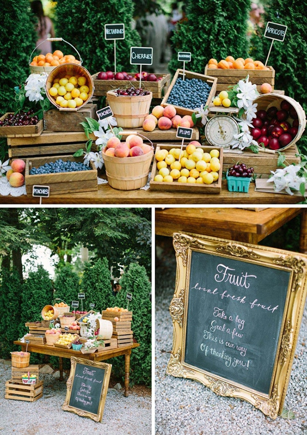 Local fresh fruit display for guests to take home as wedding favors - 'Take a bag, grab a few, this is our way of thanking you' | Andrew Mark Photography via Weddingbells