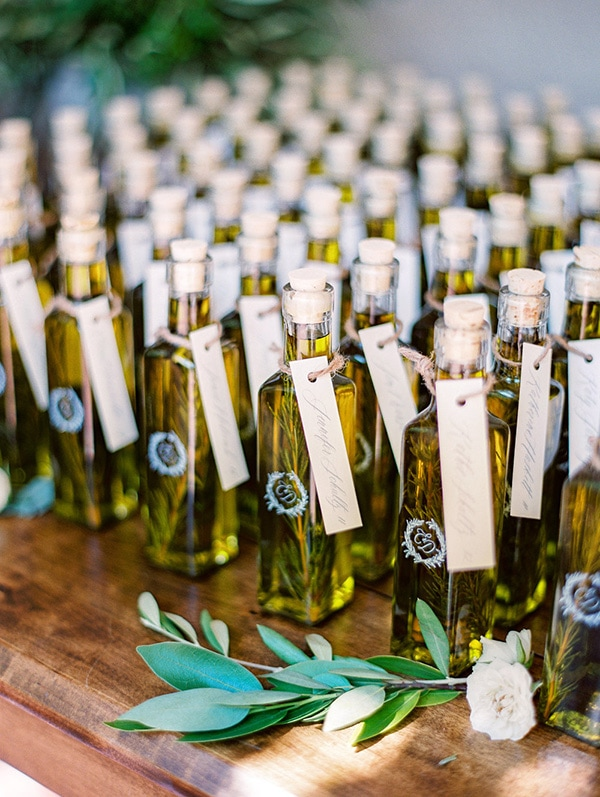 Elegant bottled olive oil wedding favors featuring the couple's monogram for a European inspired celebration | The Grovers via MODwedding