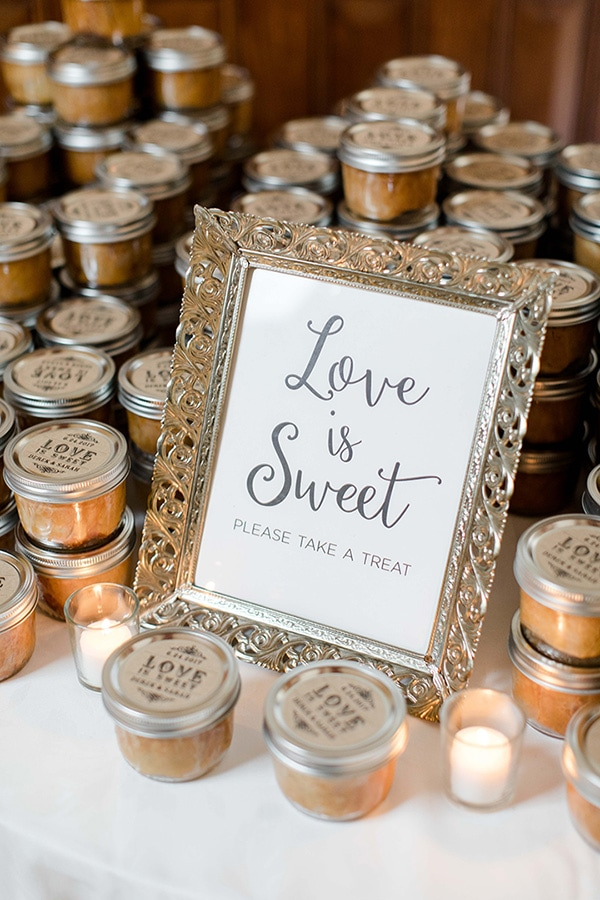 'Love is sweet, please take a treat' wedding favours in rustic vintage glass jars | Jessica Frey Photography via My Hotel Wedding