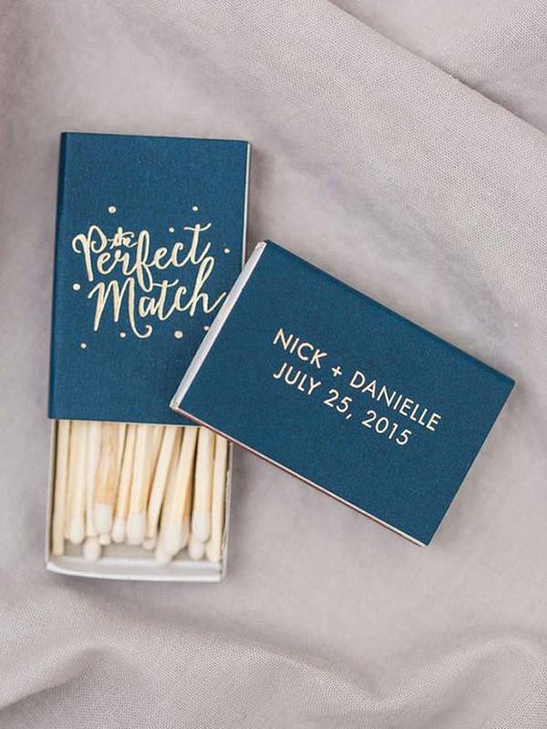 'The Perfect Match' matchbox wedding favours personalised with the couple's names and wedding date | Bradley James Photography