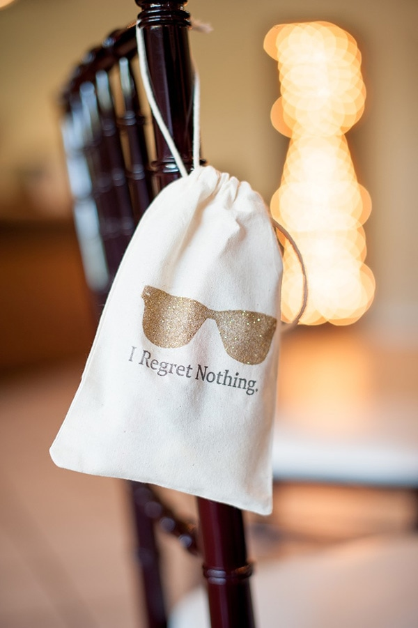 Funny 'I Regret Nothing' hangover kit wedding favor for guests with gold glitter sunglasses motif | KMH Photography via Chic Vintage Brides
