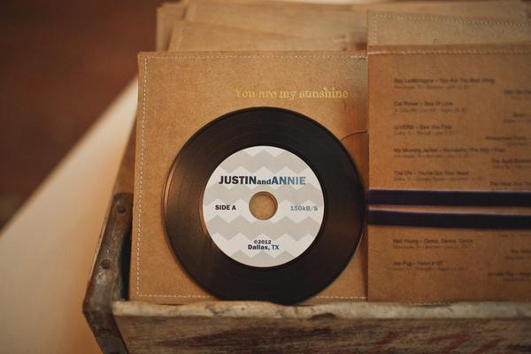 Vinyl record inspired music compilation of the couple's favourite songs as a wedding favor for guests | Taylor Lord Photography via Style Me Pretty