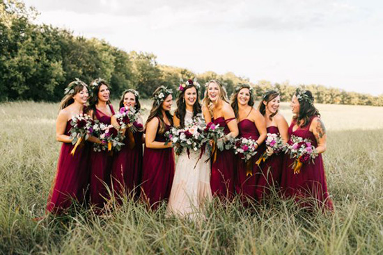 Bohemian burgundy bridesmaid dresses | Sarah Libby Photography via Junebug Weddings