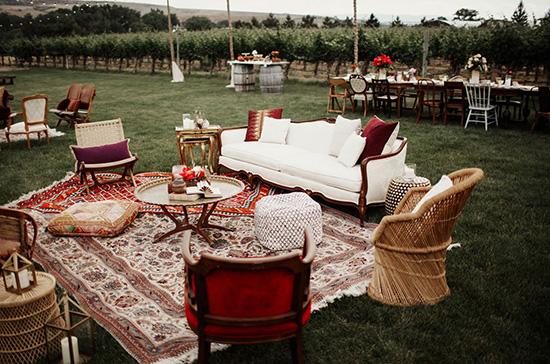 Bohemian burgundy wedding lounge for cocktail hour | Elizabeth Wells Photo via Green Wedding Shoes