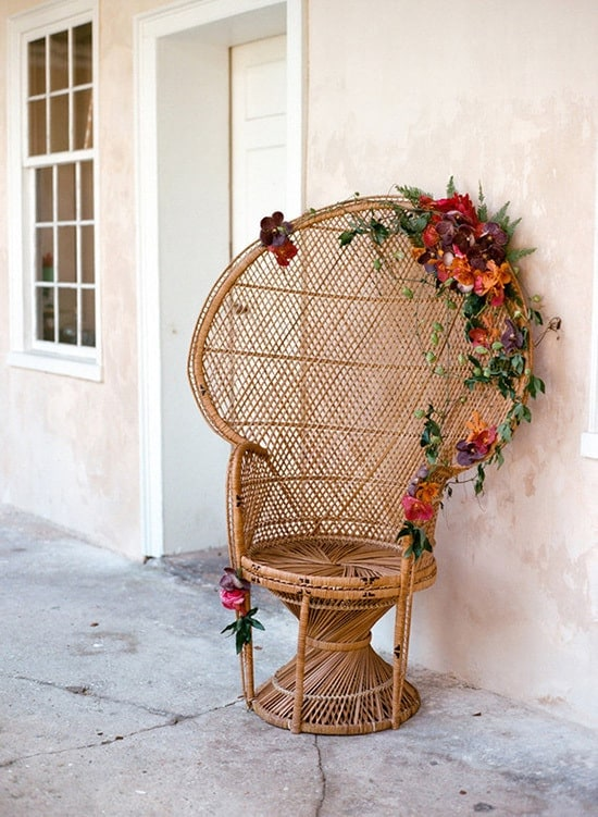 Peacock chair with burgundy flowers for bohemian wedding | E.M. Anderson via 100 Layer Cake