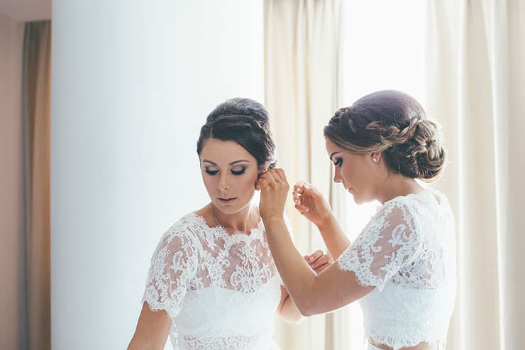 Bridesmaids in white getting ready