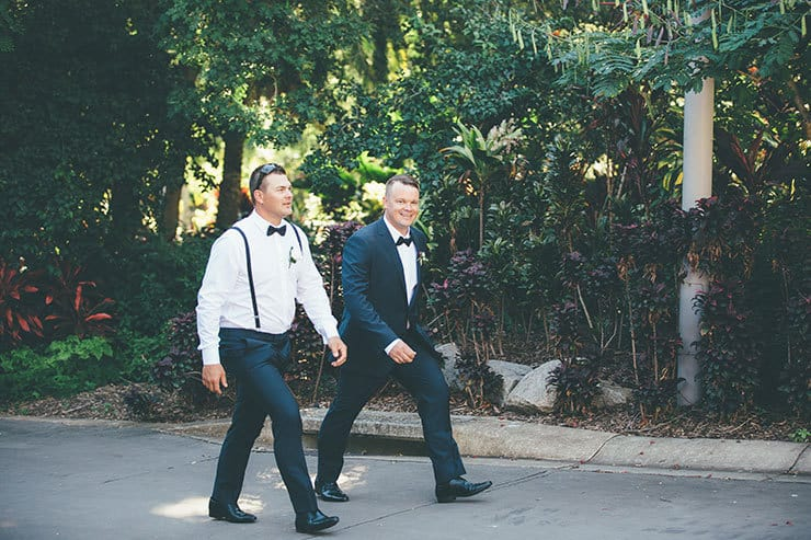 724f540021ea Groom in navy suit walking to ceremony Bohemian luxe wedding ceremony chairs