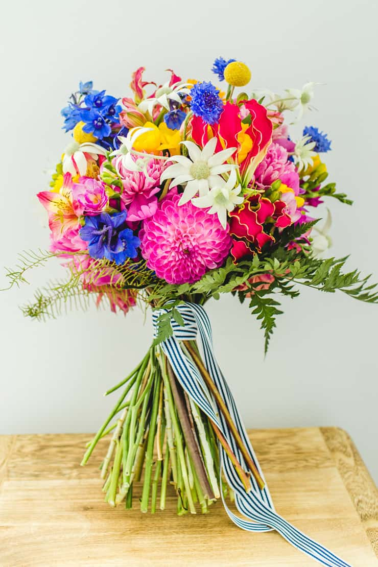 A bold and bright floral wedding the wedding playbook for Bright wedding bouquet