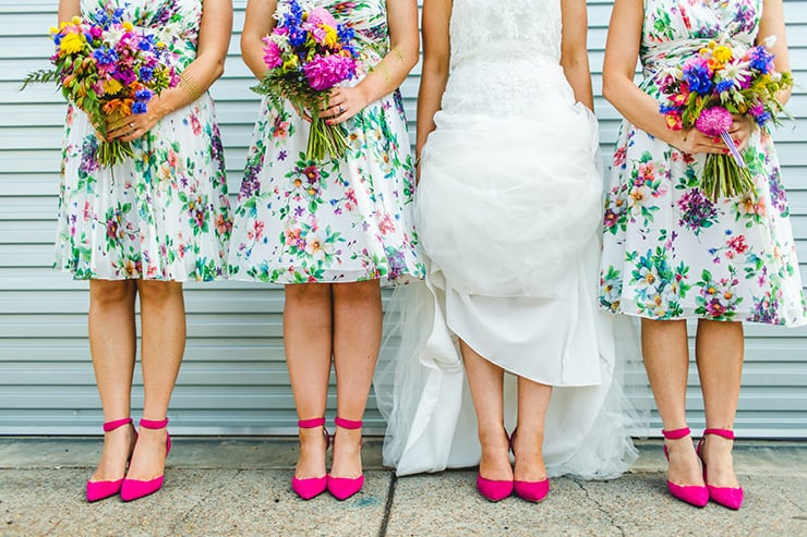 Bold-Bright-Floral-Wedding-Bride-Bridesmaids-Print-Dresses-Pink-Heels-Bouquets
