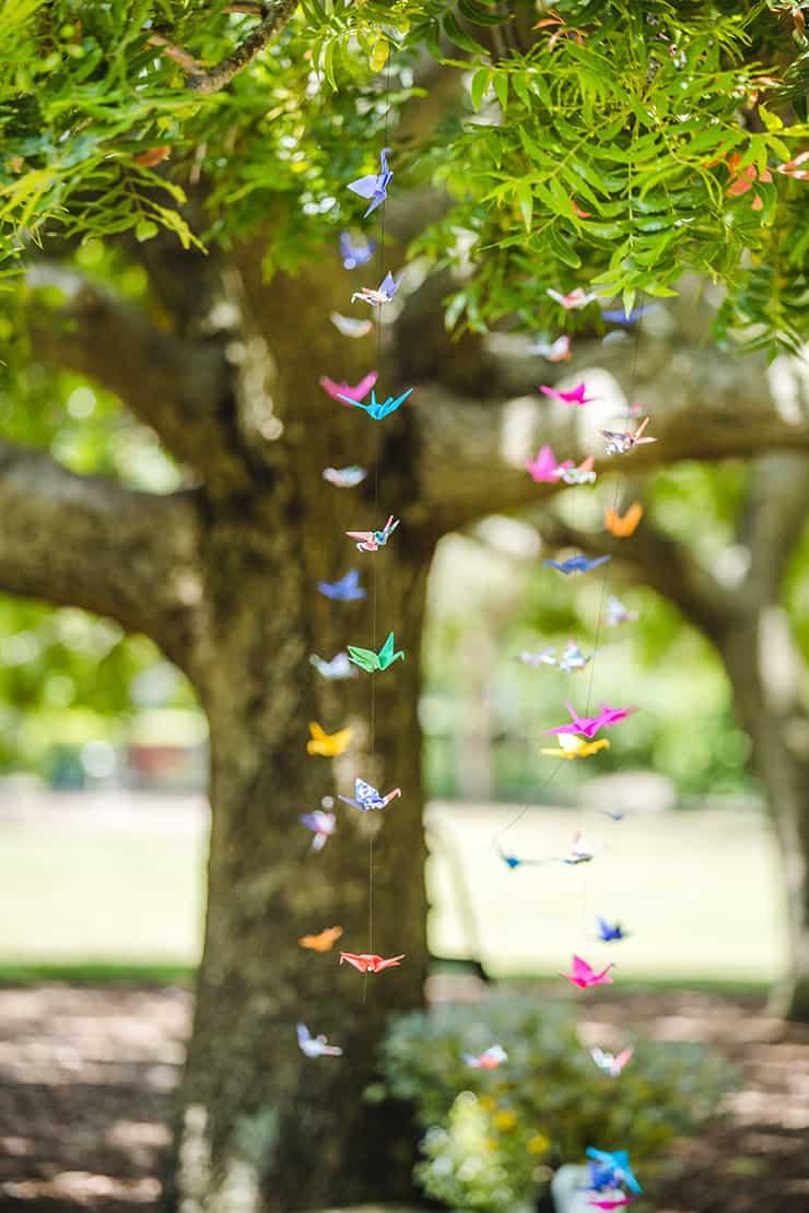 Bold-Bright-Floral-Wedding-Ceremony-Decor-Paper-Cranes
