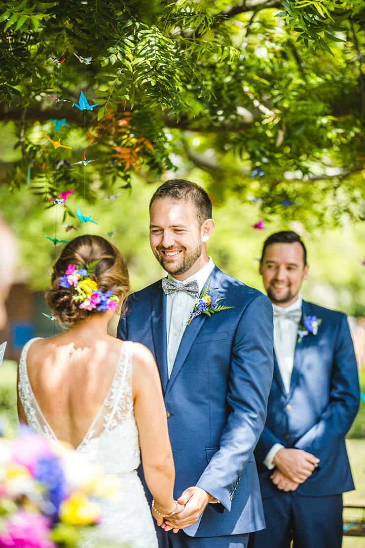 Bold-Bright-Floral-Wedding-Ceremony-Groom