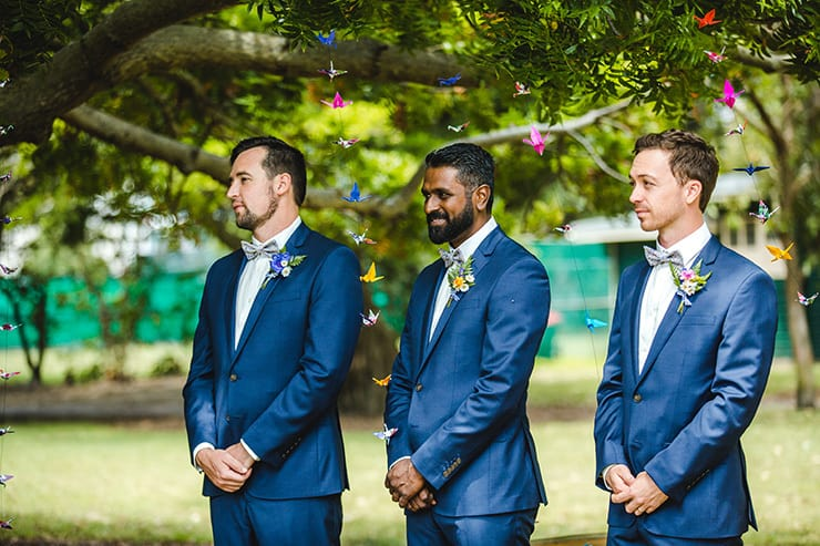 Bold-Bright-Floral-Wedding-Ceremony-Groomsmen