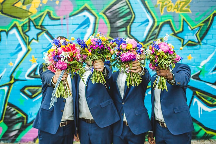 Bold-Bright-Floral-Wedding-Groom-Groomsmen-Navu-Suit-Bouquets