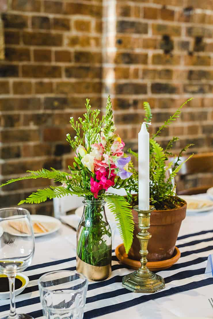 Bold-Bright-Floral-Wedding-Reception-Rustic-Styling-Flower-Candle-Centrepiece