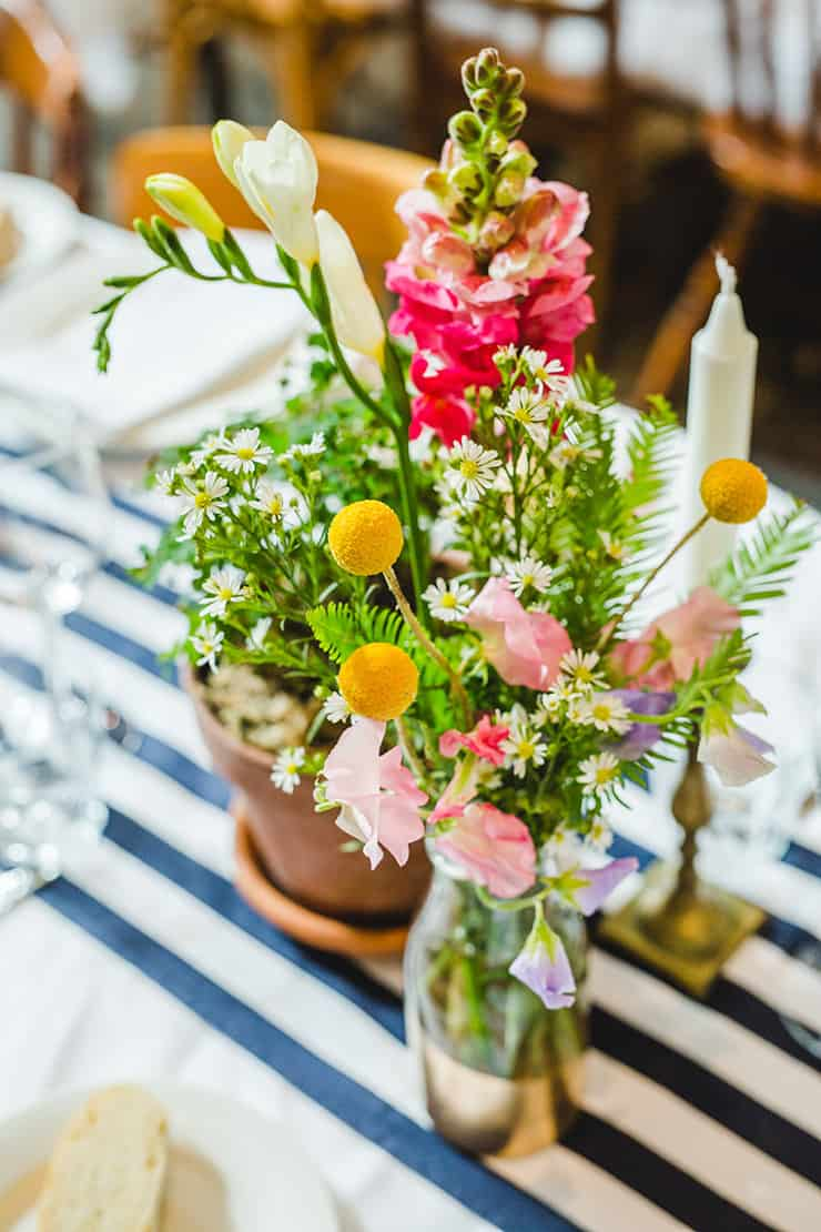 Bold-Bright-Floral-Wedding-Reception-Rustic-Styling-Flower-Centrepiece