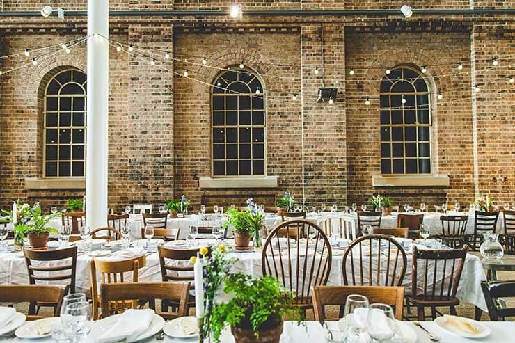 Bold-Bright-Floral-Wedding-Reception-Rustic-Styling-Mismatched-Chairs