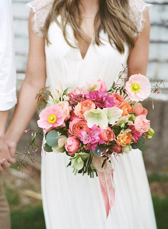 Bright modern pink and orange wedding bouquet | Lauren Fair Photography via Ruffled