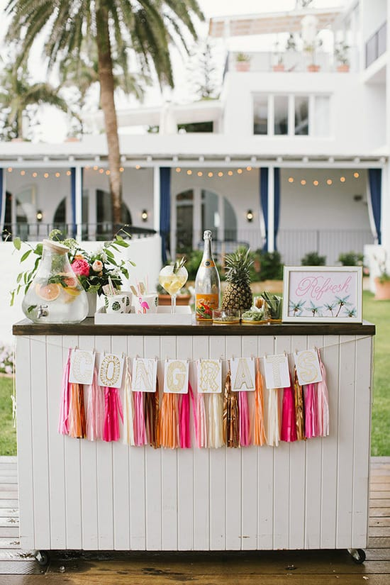 Bright tropical wedding cocktail hour bar | Heart and Colour via 100 Layer Cake