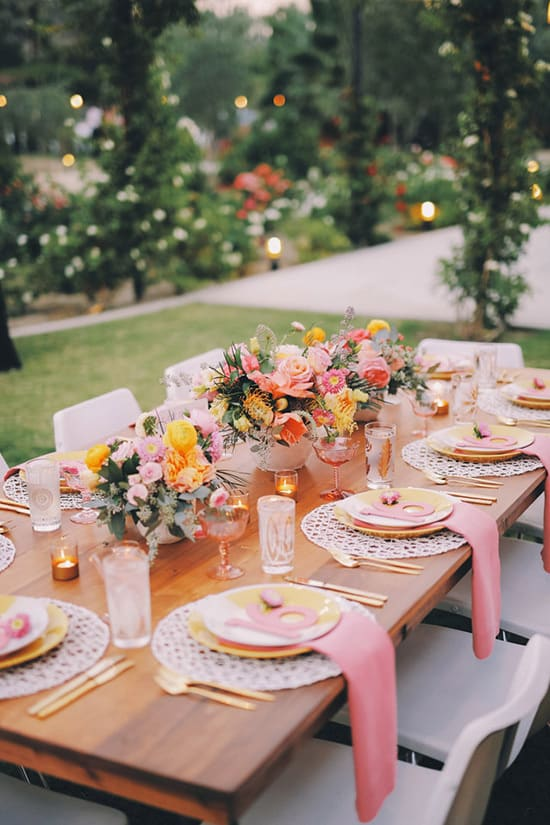Bright tropical wedding reception table with pink and orange flowers | Gideon Photography