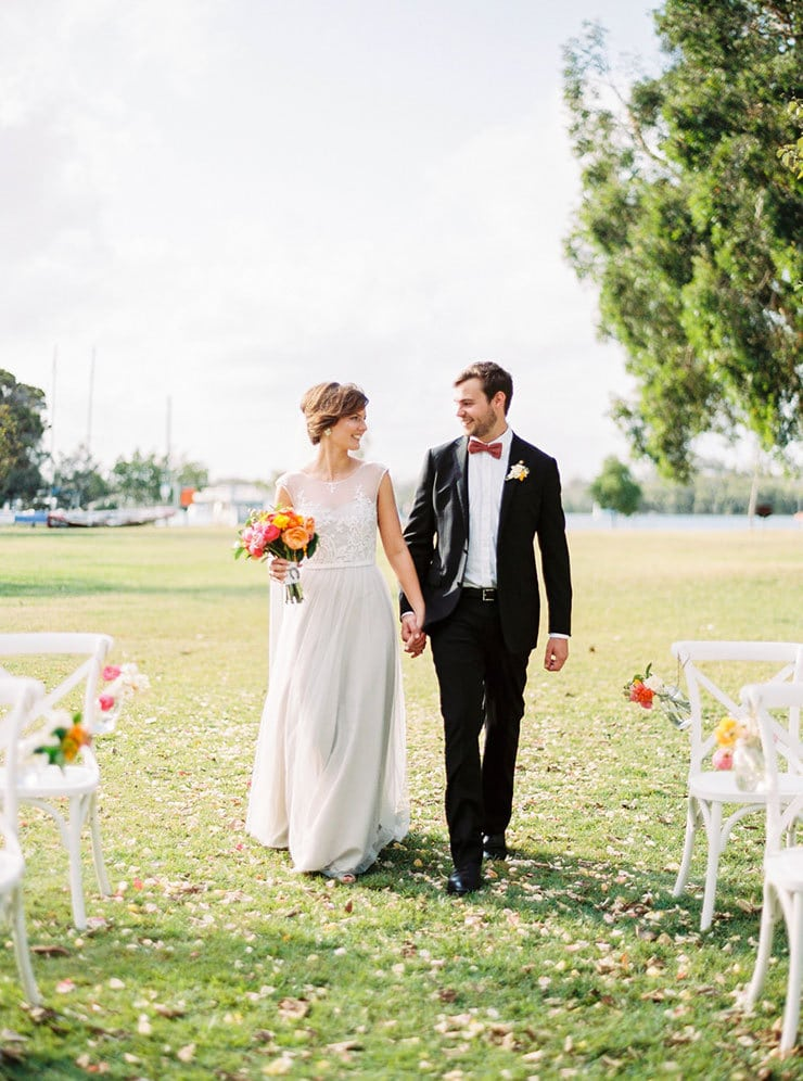 Bright-Waterfront-Cocktail-Wedding-Bride-Groom-Ceremony-Aisle