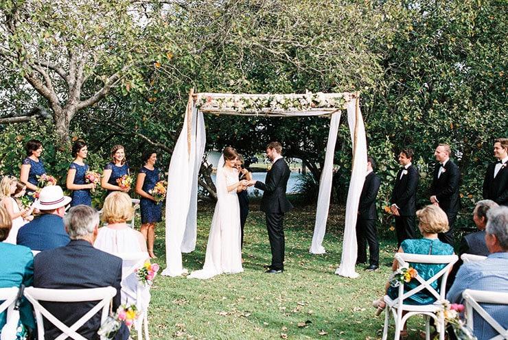 Bright-Waterfront-Cocktail-Wedding-Bride-Groom-Ceremony-Ring-Exchange