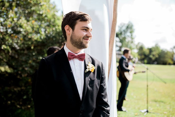 Bright-Waterfront-Cocktail-Wedding-Groom-Ceremony