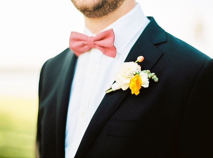 Bright-Waterfront-Cocktail-Wedding-Groom-Suit-Bow-Tie