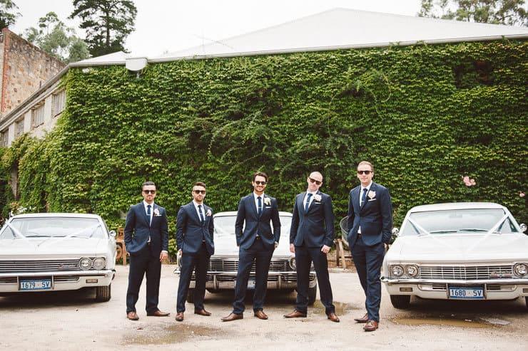 Classic-Estate-Wedding-Navy-Suit-Groom-Groomsmen-White-Boutonniere-Vintage-Car