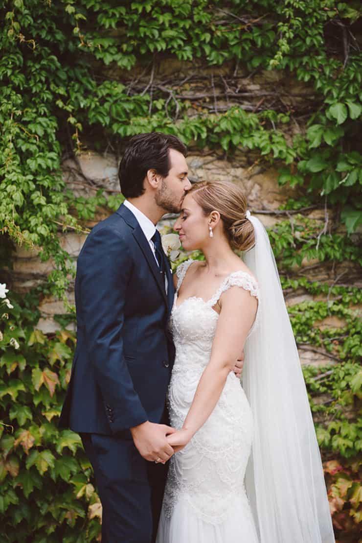 Classic-Estate-Wedding-Pink-White-Bride-Groom-Portrait-Forehead-Kiss