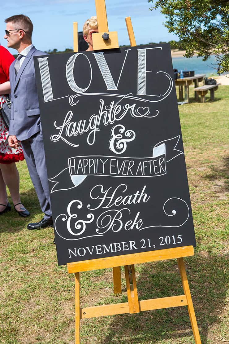 Love, Laughter & Happily Ever After wedding ceremony sign