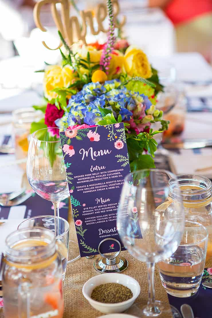 Illustrated menu and bright wedding centrepieces