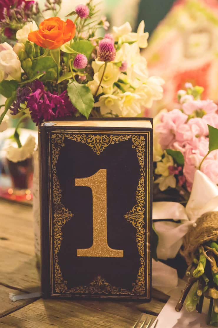 Colourful-Vintage-DIY-Wedding-Reception-Book-Table-Number-Centrepiece