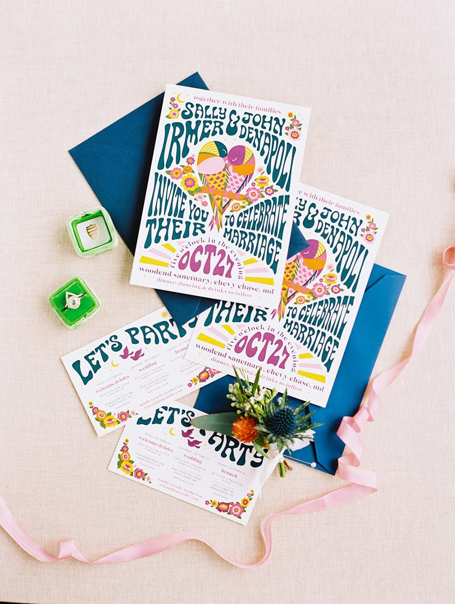 Electric Disco Wedding Ideas |  Retro 70s inspired wedding invitation suite in a purple, pink, blue, orange and yellow palette featuring groovy lettering and an illustration of two birds sitting together in the shape of a heart on a branch surrounded by flowers. | Photography: Bonnie Sen Photography via Washingtonian