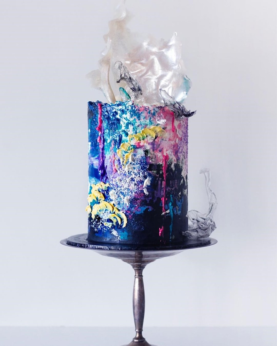 Electric Disco Wedding Ideas |  Painted buttercream wedding cake featuring graffiti style textures including yellow scales, hot pink drips and watercolour dark blue, aqua and purple icing topped with white and black isomalt sails | Photography: Sugar Sugar Cake School