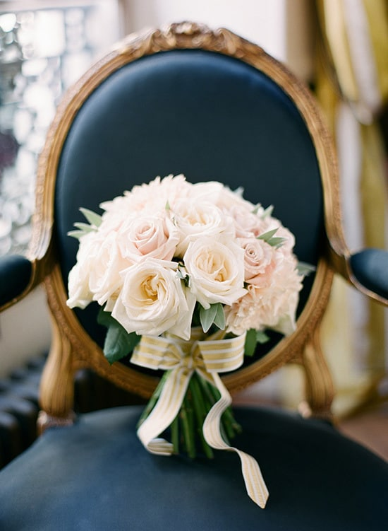 Elegant cream rose wedding bouquet on navy vintage chair | KT Merry via Style Me Pretty
