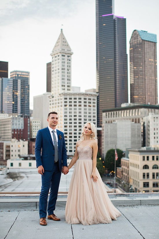 Bride wearing champagne wedding dress and groom in navy suit | Angela Shae via 100 Layer Cake