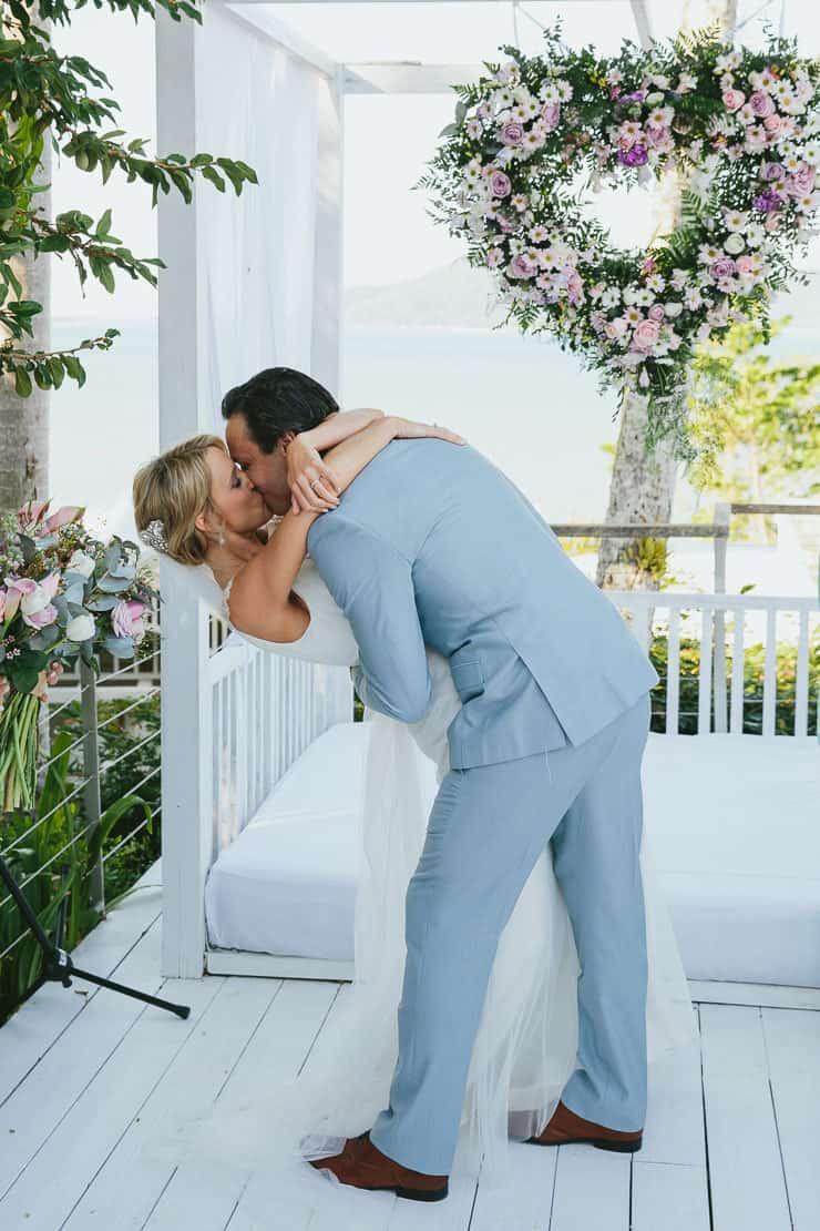 Elegant-Tropical-Wedding-Bride-Groom-Ceremony-Dip-Kiss