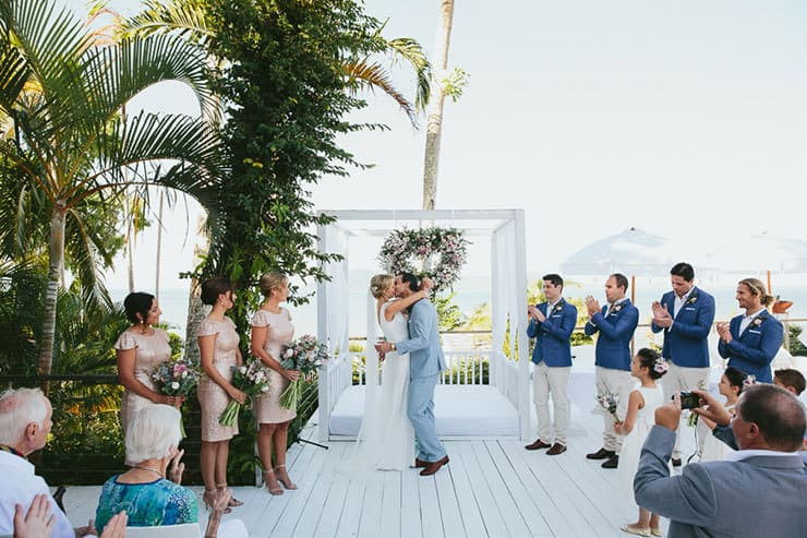 Elegant-Tropical-Wedding-Bride-Groom-Ceremony-Kiss
