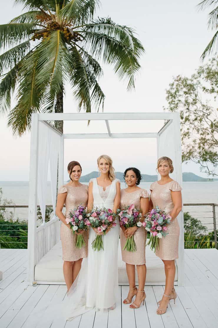 Elegant-Tropical-Wedding-Ceremony-Gold-Bridesmaid-Dresses-Bride-Poolside