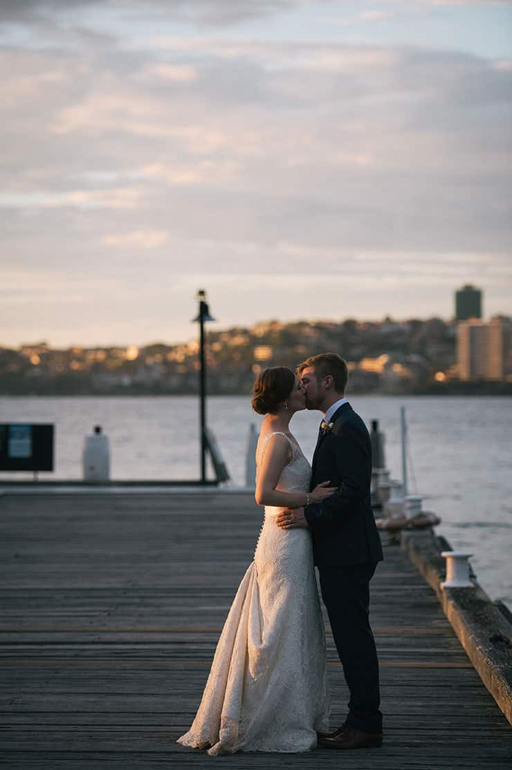 Elegant-Waterside-Wedding-Bride-Groom-Pier-Kiss