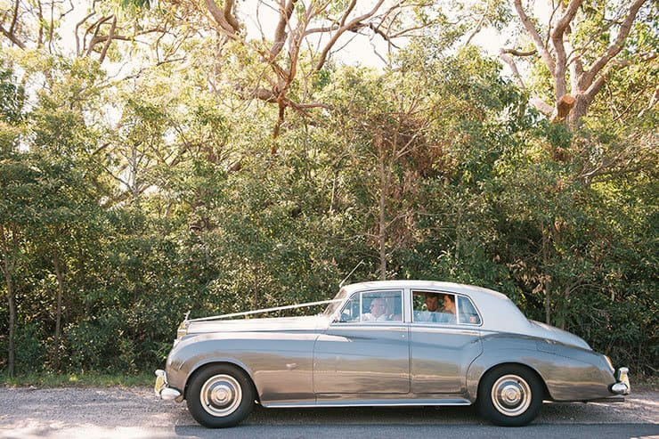 Elegant-Waterside-Wedding-Navy-&-Grey-Vintage-Car-Bride-Groom