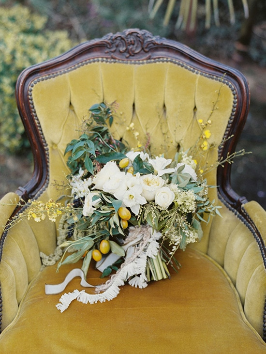 Green, white and yellow wedding bouquet on mustard velvet chair | Lauren Balingit via 100 Layer Cake