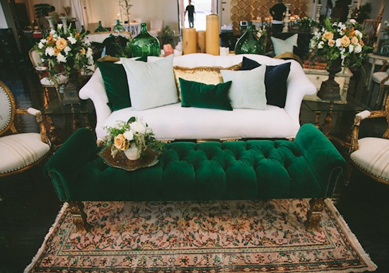 White and green velvet lounge setting with gold accent pillow | Paige Jones via 100 Layer Cake