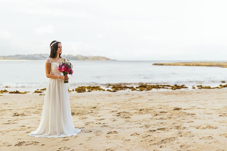 Romantic beach bride with bright wedding bouquet