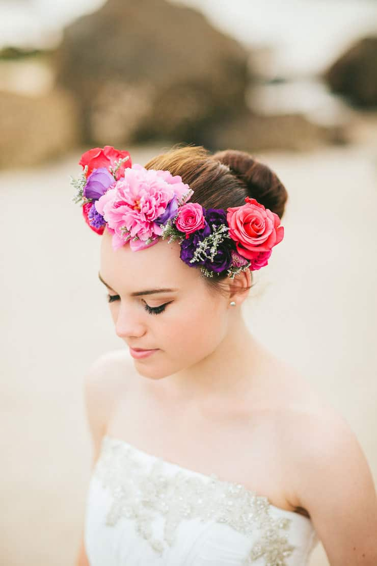 Elegant beach bride wearing bright flower crown