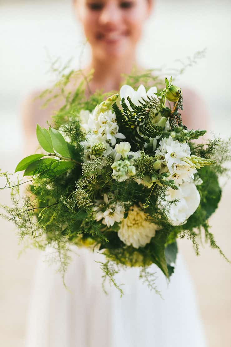 Textured green and white bride bouquet for beach wedding