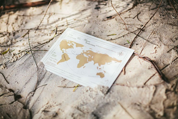 World map travel inspired wedding invitation